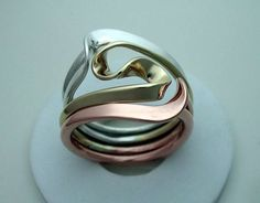 http://www.teslageneratorplans.net/energy-by-tesla-reviews.html Energy By Tesla overview. Tesla Inspired Silver 14k Yellow Gold and Copper Vortex by isidro