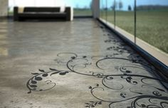 This beautiful edge treatment adds life and a little humor to an otherwise plain concrete floor.
