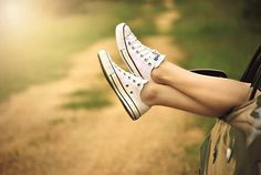 Person Showing Its Feet Wearing White Sneakers