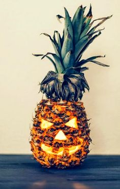 Jack-O-Lantern Pineapple Carving for a Tropical Halloween: http://www.completely-coastal.com/2014/10/jack-o-lantern-pineapple-carving-for-Halloween.html