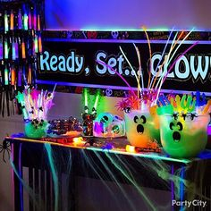 Ready, set...GLOW! Send your boo crew trick-or-treating in safety with fun glow-in-the-dark favors from a too-cute table display!