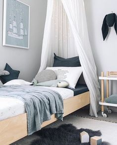 Who doesn't love a light filled room with shades of blue, grey and white?! 😍 This divine space belongs @oh.eight.oh.nine's little man Chet. Just perfection!