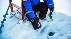 Winter - Kakslauttanen ice fishing at the HOTEL KAKSLAUTTANEN in Finland