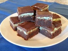Mint Chocolate Brownie Bars have a rich, fudgy brownie layered with peppermint frosting and topped with a chocolate ganache. A decadent treat for chocolate lovers! Fudgy Brownies, Chocolate Brownies, Chocolate Ganache, Mint Chocolate, Green Food Coloring, Brownie Bar, Unsweetened Cocoa, Vegetarian Chocolate, Chocolate Lovers