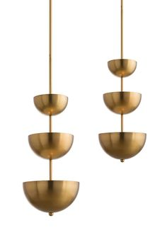 This six-light steel chandelier features a three-tier design and antique brass finish...