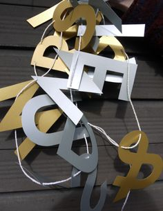 Silver and gold letter banners Our silver and gold banners are double sided, perfect for use in the middle of a space
