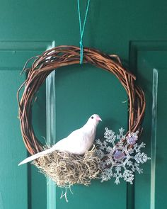 Handmade Winter Holidays Christmas Dove with Sparkle Snowflake Grapevine door Wreath - Spanish Moss and Feathers Wreath by BombPopBoutique on Etsy