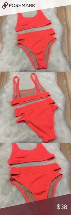 UO x Out from Under Neon High Cut 90's Bikini Lg UO x Out from Under Neon Orange High Cut 90's Style Ribbed Bikini sz Large   Awesome bikini! Severing Up neon high cut leg 90's all day. This swimsuit is lightly worn and in great shape. Both the top and bottom are a size large. No trades accepted but offers welcome Urban Outfitters Swim Bikinis