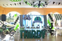 Dirt Bike Themed Dessert Table Event: Thirdy's 1st Birthday Venue Set-up: Mychoice Party Shop Dessert Table Set-up Cake Cupcakes Cookies: Sweet PEA by Genesis Sison-Basiao Cakepops: The Cakeroom Photos: Bacolod Click & Smile Photobooth