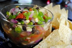 1 can black beans  2 cans Ro-tel tomatoes  1 each red and green bell peppers, diced  1 red onion, diced  1 can white shoepeg corn  1 cup Italian dressing (I use fat-free)