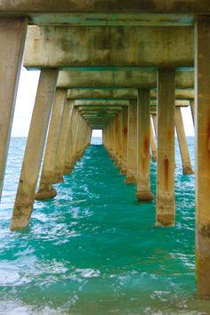 peaceful turquoise sea under the ocean pier