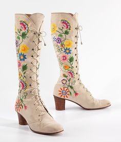 "Boots Jerry Edouard, ca. 1975. ""By the late 1960s, the bohemian influence on fashion was generating frankly historicizing and 'ethnic' effects. Proclaiming affinity with their historical predecessors, high laced boots became known as 'granny boots'. This pair of boots demonstrates both qualities, with its traditional cut and lively 'folk' type embroidery."""