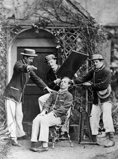 A sitter is clamped into position, using a metal framework, ready to have his portrait taken by calotype or daguerreotype  Picture: Hulton Archive/Getty Images  //Yikes!//