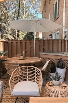 Light synthetic wicker makes the Tula ready to withstand a tropical storm or a typical Nor-easter. A Lily White weather-proof cushion needs a little more TLC (please don't leave it in the rain!) but promises to keep your butt dry and cozy for seasons to come. Photo by Brianne Penney. #OutdoorDecor #BohoPatio #PatioIdeas Wicker, Tropical, Lily, Patio, Chair, Outdoor Decor, Home Decor, Decoration Home, Room Decor