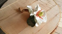 Hand sculpted Magnolia in porcelain clay.
