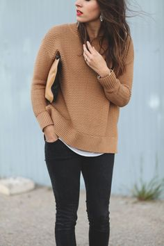 Layer a simple loose tank under your favorite knit for added warmth and style.