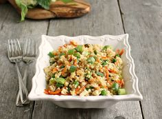 "Cauliflower ""Fried Rice"" Recipe Side Dishes with olive oil, onions, garlic, shredded carrots, peas, grated cauliflower, eggs, soy sauce, scallions, salt, pepper"