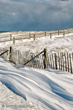 Drifting snow along the beach fences at Nauset Beach in Orleans