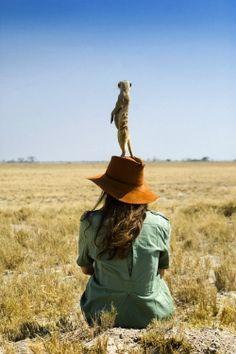 Botswana, Catherine Raphaely with meerkat (Dook Photography)