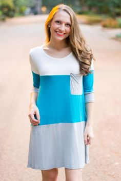 Everyone's Favorite top now in a tunic dress! We love this 3/4 sleeve dress with bold color blocked stripes! This is the perfect fall and winter transition piece! Pair with riding boots or booties for a fashionable and comfy look!