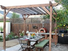 Before-and-Afters of Backyard Decks, Patios and Pergolas : Home Improvement : DIY Network---  lattice fence idea on retaining wall