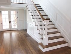 Nice mid brown with matching tred. You could do the bannister greyish black or white.