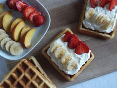 Waffles with whipped cream and fruit