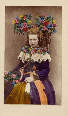 A bride from Hälsingland, Sweden hand-coloured photo, between 1870 and 1899