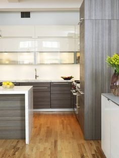Modern Kitchen - white cabinets up top, wood on bottom, waterfall countertop with seating, poggenpohl cabinetry Kitchen Cabinet Styles, Modern Kitchen Cabinets, Modern Kitchen Design, Kitchen Interior, Kitchen Contemporary, Contemporary Cabinets, Kitchen Island, Kitchen Ideas, Kitchen Furniture