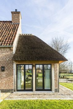 Beautiful thatched home by Architect Gruwez