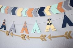A personal favorite from my Etsy shop https://www.etsy.com/listing/264434861/set-of-3-tribal-garlands-tribal-banners