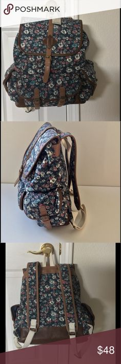 "Mudd Blue Floral Backpack NWT Blue, white &pink floral on navy background. Canvas w/ faux leather trim. Adjustable drawstring & top flap w/ magnetic closure. Outer pockets on the front and sides. Interior zip pocket & slip pockets. Adjustable padded straps. Locker tab. 15.5"" H X 5"" W X 13""L not including outer pockets. New with tags  🎀Bundle discount  ⭐️5 star rated Suggested User 🚭Smoke free home 🚫No trades please  😍 Thank you for shopping with me. Please ask all questions before…"
