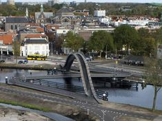 Some clever Dutch design! When NEXT architects were to design a new bridge over a narrow canal in Purmurend in the Netherlands, they wanted to accommodate bikes, pedestrians, wheelchairs and boats. The lower bridge actually swings open for bigger boats. Old Bridges, Building Costs, Bridge Design, Pedestrian Bridge, Minimalist Architecture, Drone Photography, Netherlands, Paths, Cool Photos