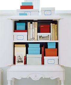 Solid colored shoe or gift boxes are perfect for storing items in a closed cabinet.