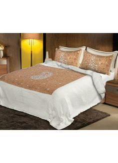 This bedsheet set consists of Bedsheet and two pillow covers which has rich golden and silver color. It is a king size.