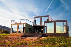 Cargo containers get a second life on land in these high-design structures.
