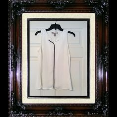 Forever 21 sleeveless blouse Forever 21 sleeveless blouse, size small, black and cream in color, excellent condition. Forever 21 Tops Blouses