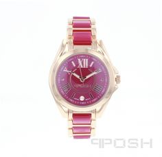 - Trendy roman numeral face design  - Made with high quality hot pink acrylic and plated in rose gold tone  - Face features exclusive POSH design  - Bracelet and full casing made in stainless steel  - Water resistant up to 5 ATM  - Extra links available  - Japanese movement    Dimensions  Face: 30mm diameter      POSH by FERI - Passion for Fashion - Luxury fashion jewelry for the designer in you.    www.gwtgalleries.com/irmaroma    Receive a $100 Gift Certificate uponyour second…