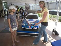 Catherine Jaunezems, an aerodynamics education specialist at NASA Langley Research Center, talks with 10-year-old Kaylie Strickland, a student from in Richmond, Va.. Credit: NASA/Sean Smith