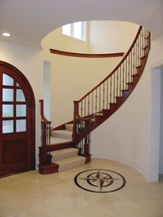 staircases and banisters traditional | This custom cherry elliptical entry stair by Adams Stair Works has ...