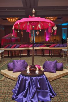 Great idea for a wedding party - indoor umbrellas with poofs to sit under and be royal - Photo by Carrie Wildes Photography via http://thebigfatindianwedding.com/2013/nadia-adils-flower-filled-muslim-wedding-tampa-bay/