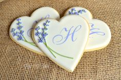 Perfect for your bridal shower or wedding!!!  These are Large heart shaped cookies personalized with your single initial monogram! Two sprigs of lavender are hand-piped onto a white background. Monograms are created with a victorian font stencil. This listing is for 12 monogrammed, heart shaped cookies. Background color is white in photo, but can be changed. These are Delicious Vanilla Sugar Cookies, beautifully iced with shiny Vanilla Flavored Royal Icing and are always made to order…