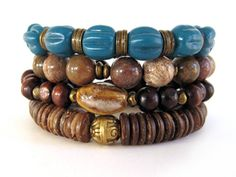 Beautiful Bohemian beaded stretch bracelets featuring 10mm cappuccino jasper beads, teal fluted glass beads handcrafted from Java, Indonesia, 8mm wood beads, ceramic focal bead, coconut wheel beads and antiqued gold-tone accent beads. A wonderful handmade bracelet stack that blends well and the teal beads adds the perfect pop of color. Invite your own bracelets to an arm party with these handmade bracelets and you'll be styling!