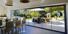 Frameless Glass Curtains offer bifolding doors with less framing than typical aluminium bifolding doors