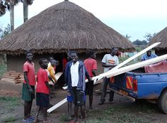 Family Care Uganda's school for war orphans in Gulu.  Happy to be helping with wood or chores!