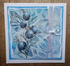 """By Bianca van Noort. Background from acrylic paint, Distress Ink, and embossing powder. Uses stamp from """"Delicate Florals"""" by Penny Black."""