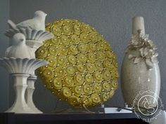 Egg Cartons! Yes, egg cartons! Great way to recycle a bunch to make this floral decor piece!