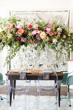 Eclectic Warehouse Wedding Inspiration. Pinks, blush, corals, and gold for the color scheme. A flower crown for the bride. Maps and vintage books and furniture for reception decor. Giant balloons and streamers for fun. Floral garlands for the sweetheart table, and a hanging floral arrangement above the table.