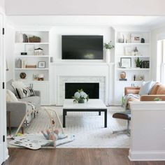 This neutral living room with a marble fireplace and white built-ins still has some work to do Living Room Decor Fireplace, Home Fireplace, Home Living Room, Living Room Designs, Family Room Fireplace, Living Room Ideas With Fireplace And Tv, Neutral Living Rooms, Living Room White, White Rooms