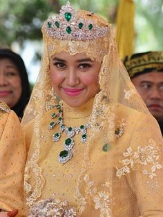 PRINCESS OF BRUNEI~ Gem studded shoes, emeralds the size of quails' eggs and a bouquet made of JEWELS: Sultan of Brunei's son celebrates wedding with mind-boggling splendour Prince Abdul Malik, 31, marries data analyst Dayangku Raabi'atul 'Adawiyyah Pengiran Haji Bolkiah, 22, today Malik is the youngest child of the Sultan and wife, Queen Saleha, and is second in line to become the next Sultan Read